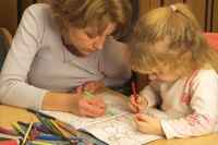 Woman and child coloring